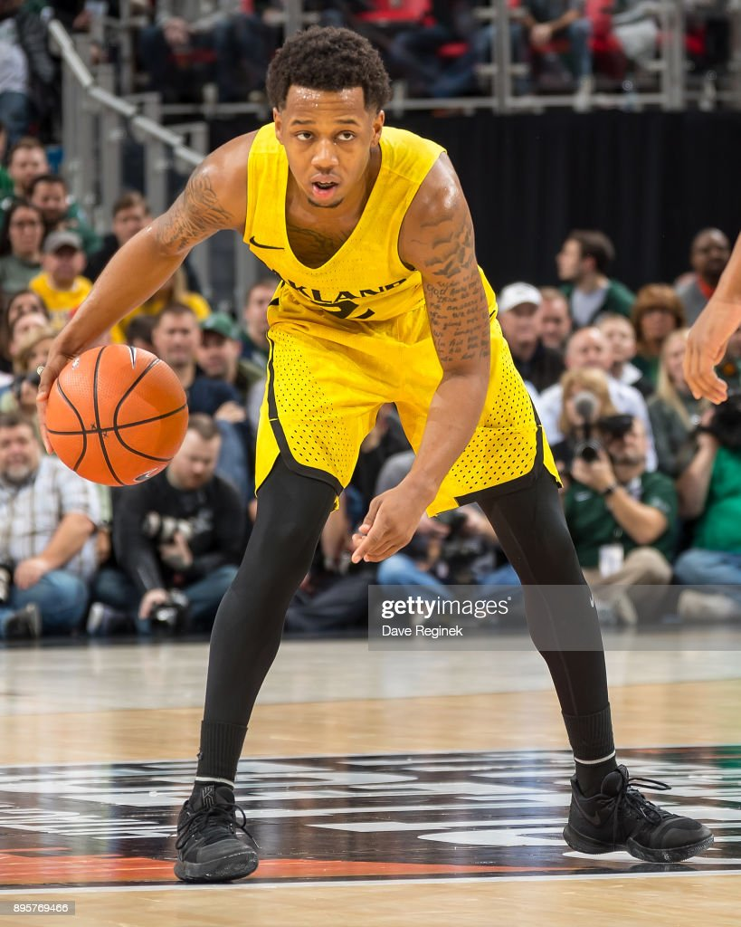 Nick Daniels #2 of the Oakland Golden Grizzlies controls the ball against the Michigan State Spartans during game two of the Hitachi College Basketball Showcase at Little Caesars Arena on December 16, 2017 in Detroit, Michigan. The Spartans defeated the Grizzles 86-73.