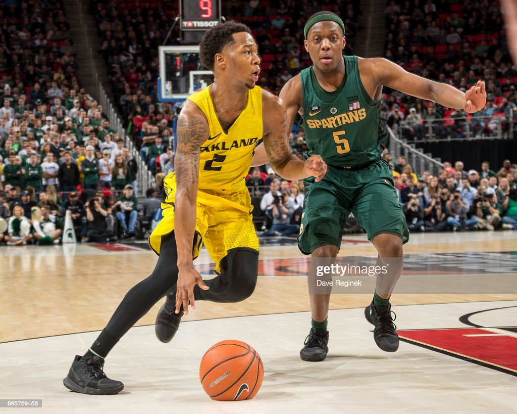 Nick Daniels #2 of the Oakland Golden Grizzlies drives to the basket against Cassius Winston #5 of the Michigan State Spartans during game two of the Hitachi College Basketball Showcase at Little Caesars Arena on December 16, 2017 in Detroit, Michigan. The Spartans defeated the Grizzles 86-73.