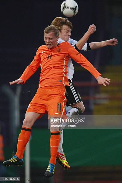 Nick De Bondt of Netherlands and Marcel Deelen of Germany head for the ball during the U18 international friendly match between Germany and...