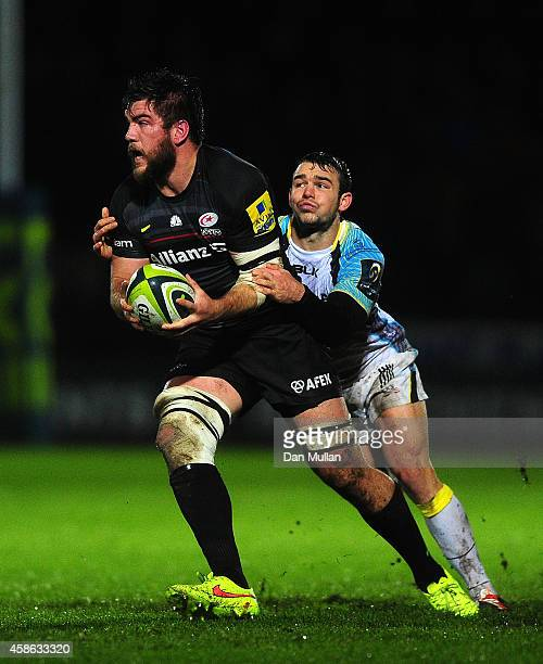 Nick de Jaeger of Saracens is tackled by Tom Habberfield of Ospreys during the LV= Cup match between Ospreys and Saracens at The Gnoll on November 7...