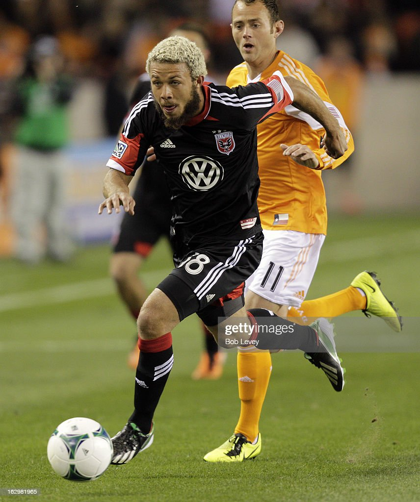 Nick DeLeon #18 of the D.C. United brings the ball up the field as he is pursued by Brad Davis #11 of the Houston Dynamo during first half action at BBVA Compass Stadium on March 2, 2013 in Houston, Texas.