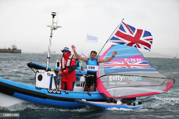 Nick Dempsey of Great Britain celebrates after winning silver in the Men's RSX Sailing on Day 11 of the London 2012 Olympic Games at the Weymouth...