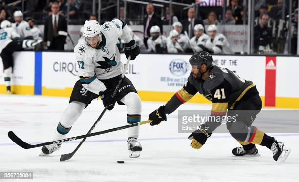 Nick DeSimone of the San Jose Sharks skates with the puck against PierreEdouard Bellemare of the Vegas Golden Knights in the third period of their...