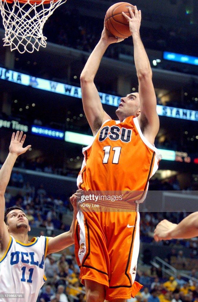 Nick DeWitz of Oregon State shoots over UCLA's <a gi-track='captionPersonalityLinkClicked' href=/galleries/search?phrase=Jordan+Farmar&family=editorial&specificpeople=228137 ng-click='$event.stopPropagation()'>Jordan Farmar</a> during 79-72 first-round victory in the Staples Center in Los Angeles, California on Thursday, March 10, 2005.
