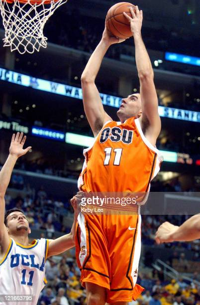 Nick DeWitz of Oregon State shoots over UCLA's Jordan Farmar during 7972 firstround victory in the Staples Center in Los Angeles California on...