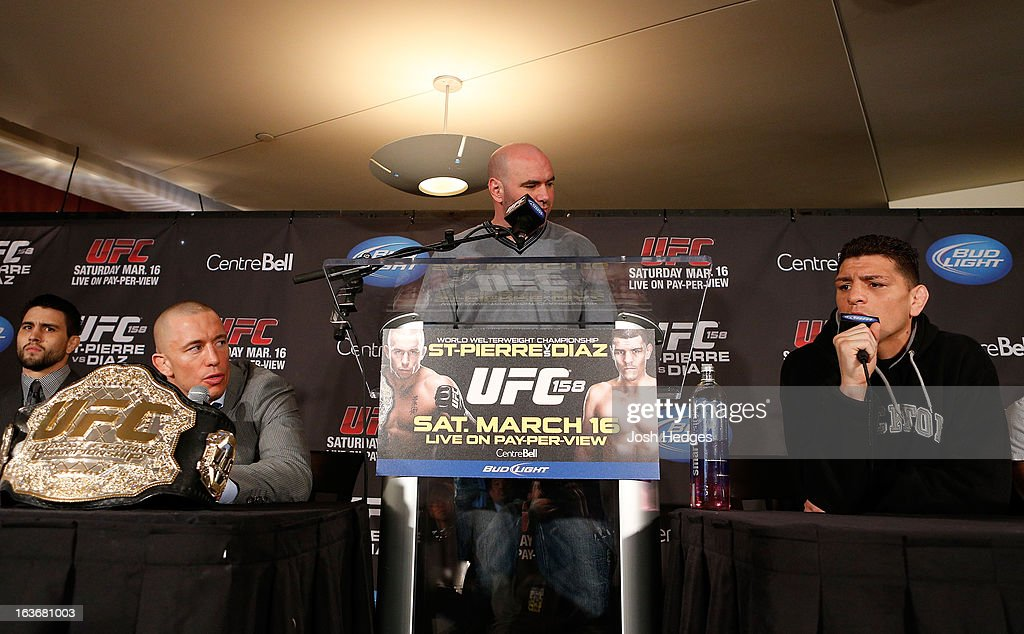 Nick Diaz (R) and Georges St-Pierre (L) argue with each other during the final press conference ahead of his UFC 158 bout at Bell Centre on March 14, 2013 in Montreal, Quebec, Canada.