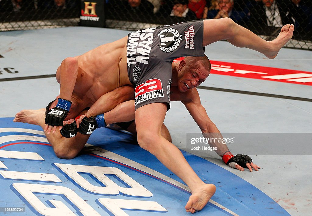 Nick Diaz attempts to escape from bottom position against Georges St-Pierre in their welterweight championship bout during the UFC 158 event at Bell Centre on March 16, 2013 in Montreal, Quebec, Canada.
