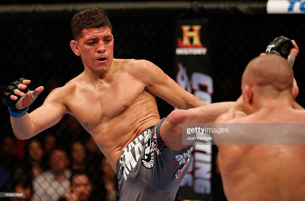 Nick Diaz kicks Georges St-Pierre in their welterweight championship bout during the UFC 158 event at Bell Centre on March 16, 2013 in Montreal, Quebec, Canada.