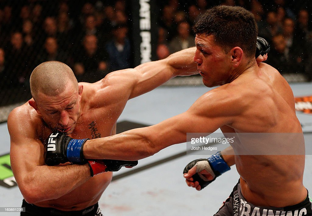 Nick Diaz punches Georges St-Pierre in their welterweight championship bout during the UFC 158 event at Bell Centre on March 16, 2013 in Montreal, Quebec, Canada.