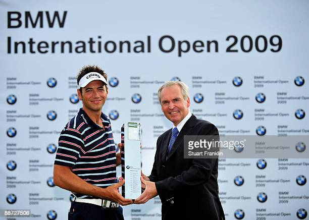 Nick Dougherty of England is presented with the winners trophy by Doctor Friedrich Eichiner Member of the board of the BMW group after the final...