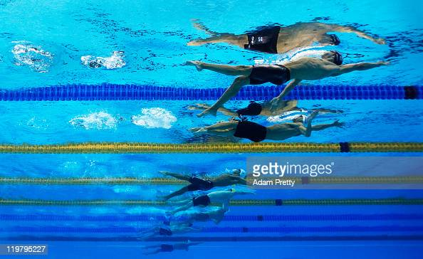 Nick Drebergen of the Netherlands Nicholas Thomas of the United States Ryosuke Irie of Japan and Helge Meeuw of Germany compete in heat five of the...