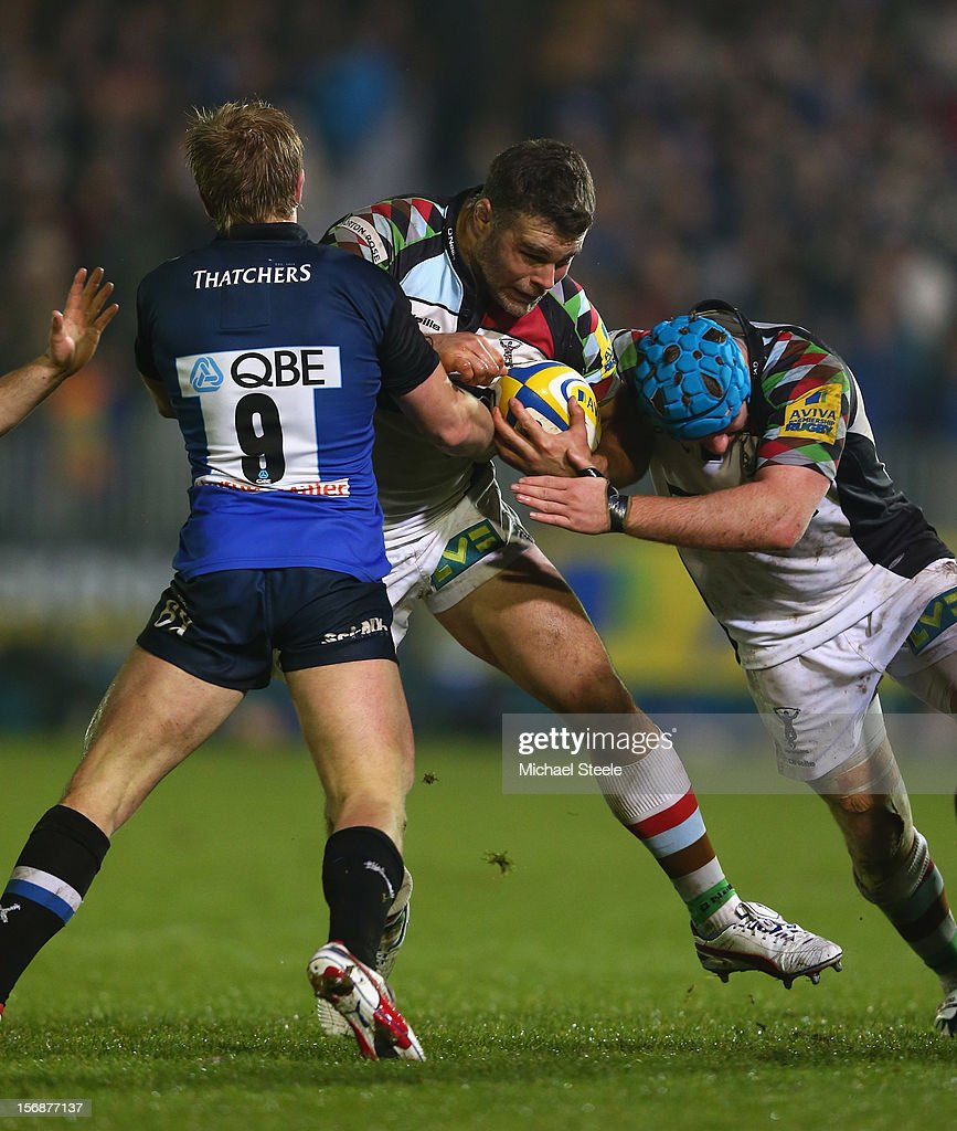 Nick Easter (C) and Joe Gray (R) of Harlequins run at Michael Claassens (L) of Bath during the Aviva Premiership match between Bath and Harlequins at the Recreation Ground on November 23, 2012 in Bath, England.