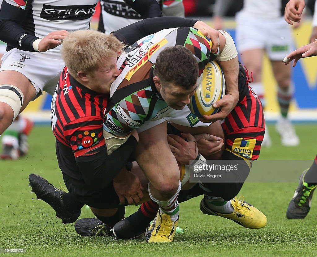 Nick Easter of Harlequins is tackled by Jackson Wray (L) and Will Fraser during the Aviva Premiership match between Saracens and Harlequins at Allianz Park on March 24, 2013 in Barnet, England.