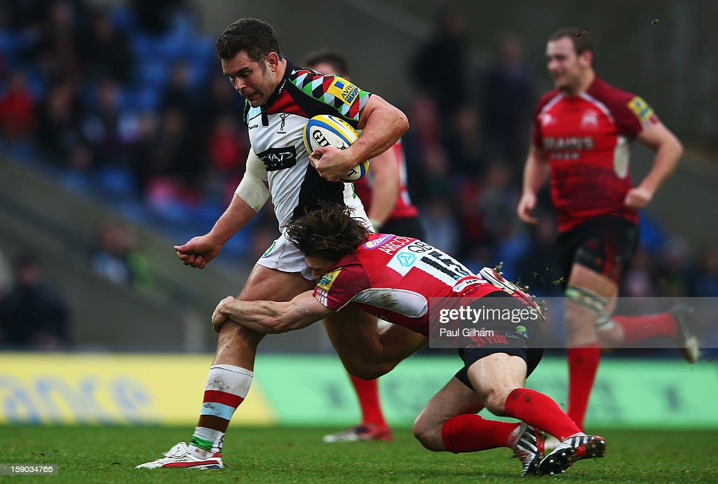 <a gi-track='captionPersonalityLinkClicked' href=/galleries/search?phrase=Nick+Easter&family=editorial&specificpeople=686040 ng-click='$event.stopPropagation()'>Nick Easter</a> of Harlequins is tackled by Tom Arscott of London Welsh during the Aviva Premiership match between London Welsh and Harlequins at Kassam Stadium on January 6, 2013 in Oxford, England.