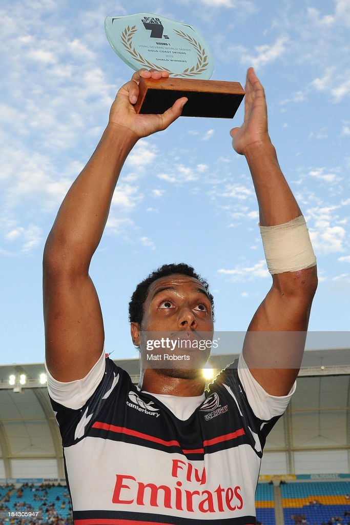 Nick Edwards of the United States hold the Shield trophy aloft during the Gold Coast Sevens Shield final match between the United States and Portugal at Skilled Stadium on October 13, 2013 on the Gold Coast, Australia.