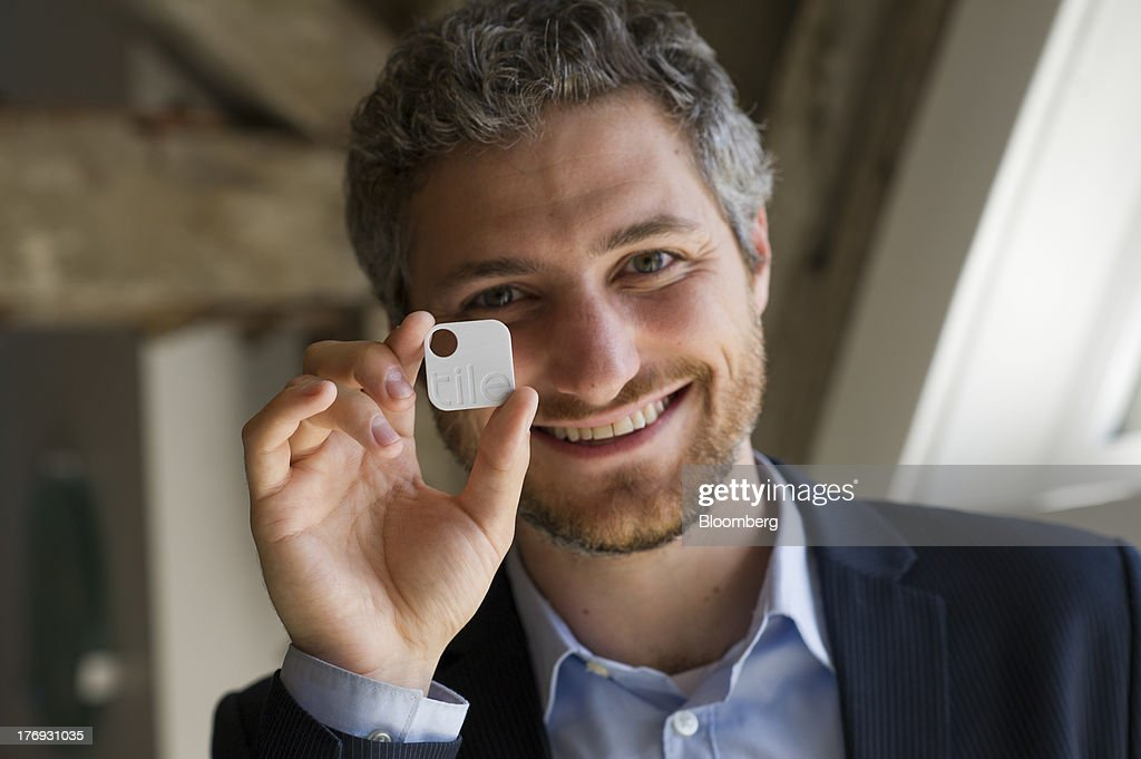 Nick Evans, co-founder of Reveal Labs and chief executive officer of Tile, holds a Tile Bluetooth device after a Bloomberg West Television interview in San Francisco, California, U.S., on Friday, Aug. 16, 2013. Tiles are Bluetooth tags that help find lost items on which the device is attached. Photographer: David Paul Morris/Bloomberg via Getty Images