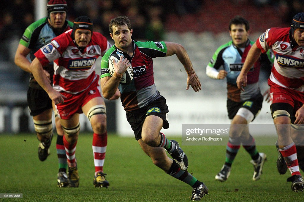 Nick Evans of Harlequins breaks through the Gloucester defence to score a try during the Guinness Premiership match between Harlequins and Gloucester...