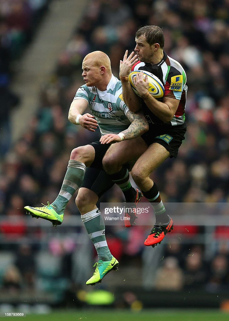 <a gi-track='captionPersonalityLinkClicked' href=/galleries/search?phrase=Nick+Evans+-+Rugby+Player&family=editorial&specificpeople=724634 ng-click='$event.stopPropagation()'>Nick Evans</a> of Harlequins claims a high ball from <a gi-track='captionPersonalityLinkClicked' href=/galleries/search?phrase=Tom+Homer&family=editorial&specificpeople=4948122 ng-click='$event.stopPropagation()'>Tom Homer</a> of London Irish during the Aviva Premiership match between Harlequins and London Irish at Twickenham Stadium on December 29, 2012 in London, England.