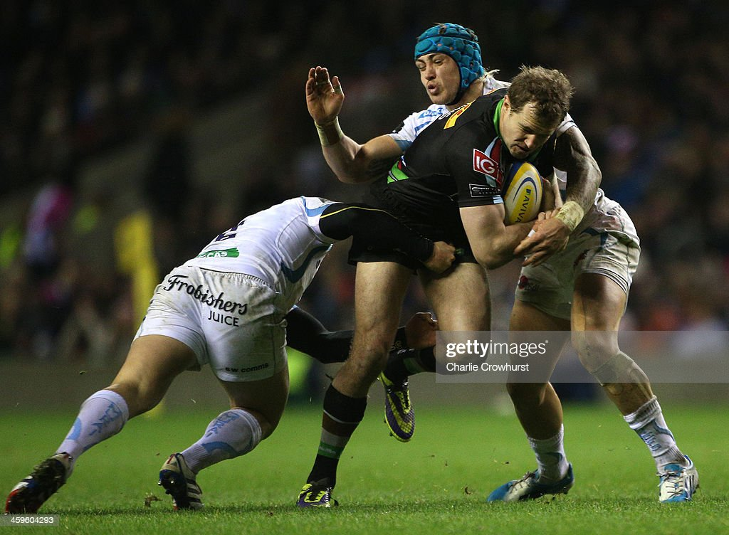 <a gi-track='captionPersonalityLinkClicked' href=/galleries/search?phrase=Nick+Evans+-+Rugby+Player&family=editorial&specificpeople=724634 ng-click='$event.stopPropagation()'>Nick Evans</a> of Harlequins is tackled by Exeter pair Jack Yendle and Jack Nowell during the Aviva Premiership match between Harlequins and Exeter Chiefs at Twickenham Stadium on December 28, 2013 in London, England.