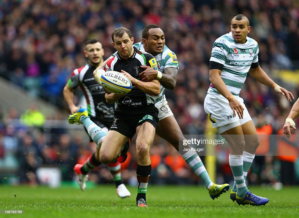 <a gi-track='captionPersonalityLinkClicked' href=/galleries/search?phrase=Nick+Evans+-+Rugby+Player&family=editorial&specificpeople=724634 ng-click='$event.stopPropagation()'>Nick Evans</a> of Harlequins is tackled by <a gi-track='captionPersonalityLinkClicked' href=/galleries/search?phrase=Sailosi+Tagicakibau&family=editorial&specificpeople=625319 ng-click='$event.stopPropagation()'>Sailosi Tagicakibau</a> of London Irish during the Aviva Premiership match between Harlequins and London Irish at Twickenham Stadium on December 29, 2012 in London, England.
