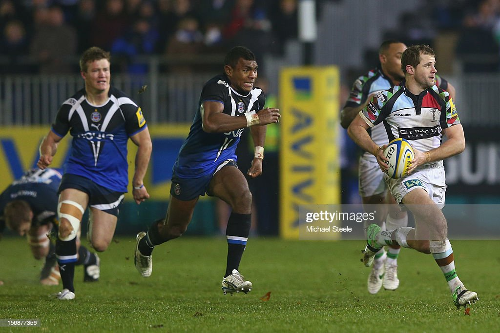 Nick Evans (R) of Harlequins looks for support as he breaks away from Semesa Rokoduguni (C) of Bath during the Aviva Premiership match between Bath and Harlequins at the Recreation Ground on November 23, 2012 in Bath, England.