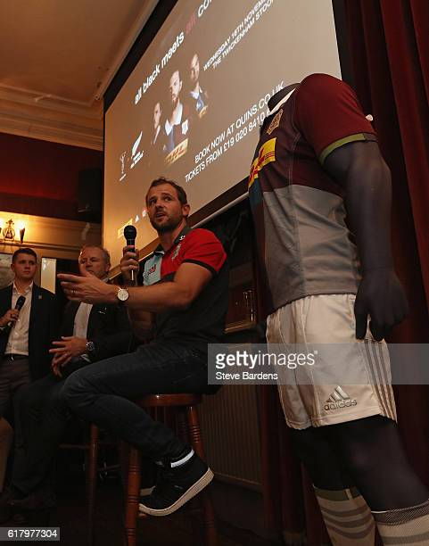 Nick Evans of Harlequins speaks with former New Zealand captain Sean Fitzpatrick during An Evening with Nick Evans and Sean Fitzpatrick at the...