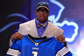 Nick Fairley #13 overall pick by the Detroit Lions holds up a jersey during the 2011 NFL Draft at Radio City Music Hall on April 28 2011 in New York...