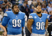 Nick Fairley and Ndamukong Suh of the Detroit Lions look on prior to the game against the New York Giants at Ford Field on December 22 2013 in...