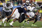 Nick Fairley of the Auburn Tigers sacks Darron Thomas of the Oregon Ducks in the fourth quarter of the Tostitos BCS National Championship Game at...