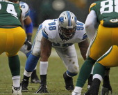 Nick Fairley of the Detroit Lions awaits the snap against the Green Bay Packers at Lambeau Field on January 1 2012 in Green Bay Wisconsin The Packers...