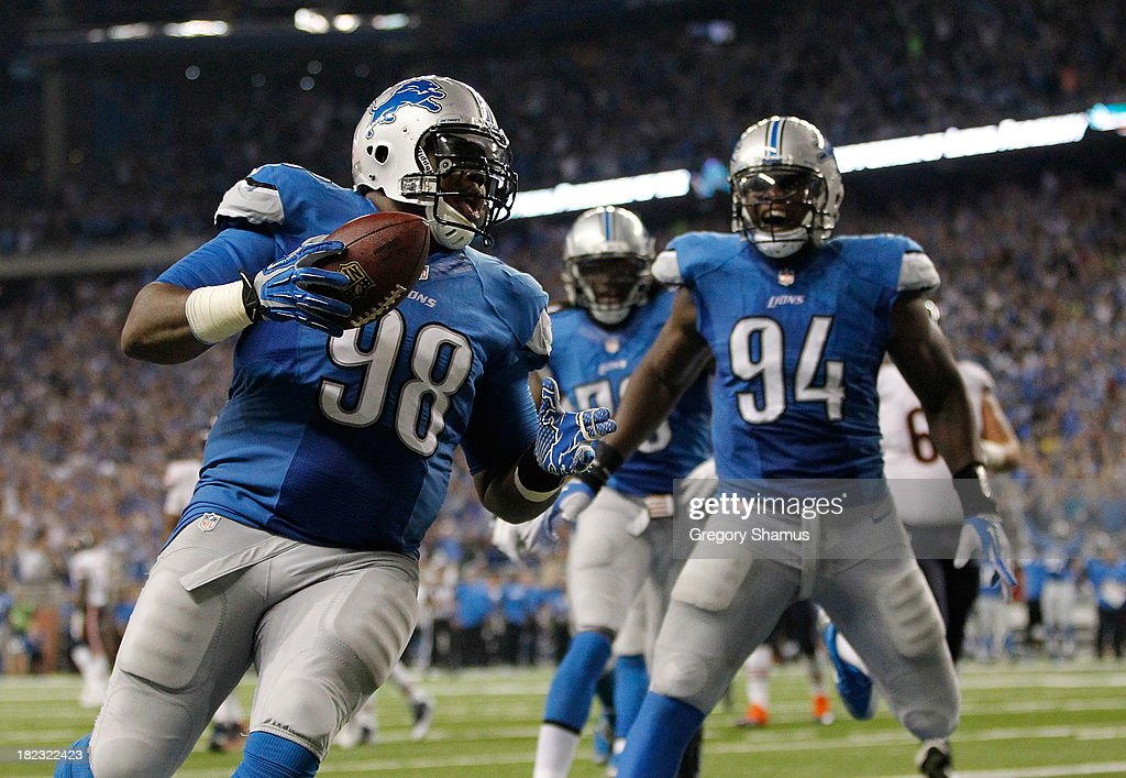 Nick Fairley #98 of the Detroit Lions celebrates a third quarter touchdown with Ezekiel Ansah #94 while playing the Chicago Bears at Ford Field on September 29, 2013 in Detroit, Michigan.