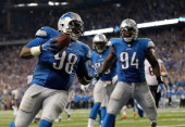 Nick Fairley of the Detroit Lions celebrates a third quarter touchdown with Ezekiel Ansah while playing the Chicago Bears at Ford Field on September...