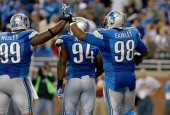 Nick Fairley of the Detroit Lions celebrates his thirdquarter touchdown with teammate CJ Mosley while playing the Chicago Bears at Ford Field on...