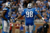 Nick Fairley of the Detroit Lions celebrates his thirdquarter touchdown with teammate Ezekiel Ansah while playing the Chicago Bears at Ford Field on...