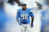 Nick Fairley of the Detroit Lions enters the playing field prior to the start of the game against the Dallas Cowboys at Ford Field on October 27 2013...