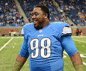 Nick Fairley of the Detroit Lions looks on prior to the game against the Tampa Bay Buccaneers at Ford Field on November 24 2013 in Detroit Michigan...