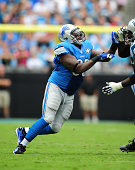 Nick Fairley of the Detroit Lions rushes the passer against Byron Bell of the Carolina Panthers at Bank of America Stadium on September 14 2014 in...