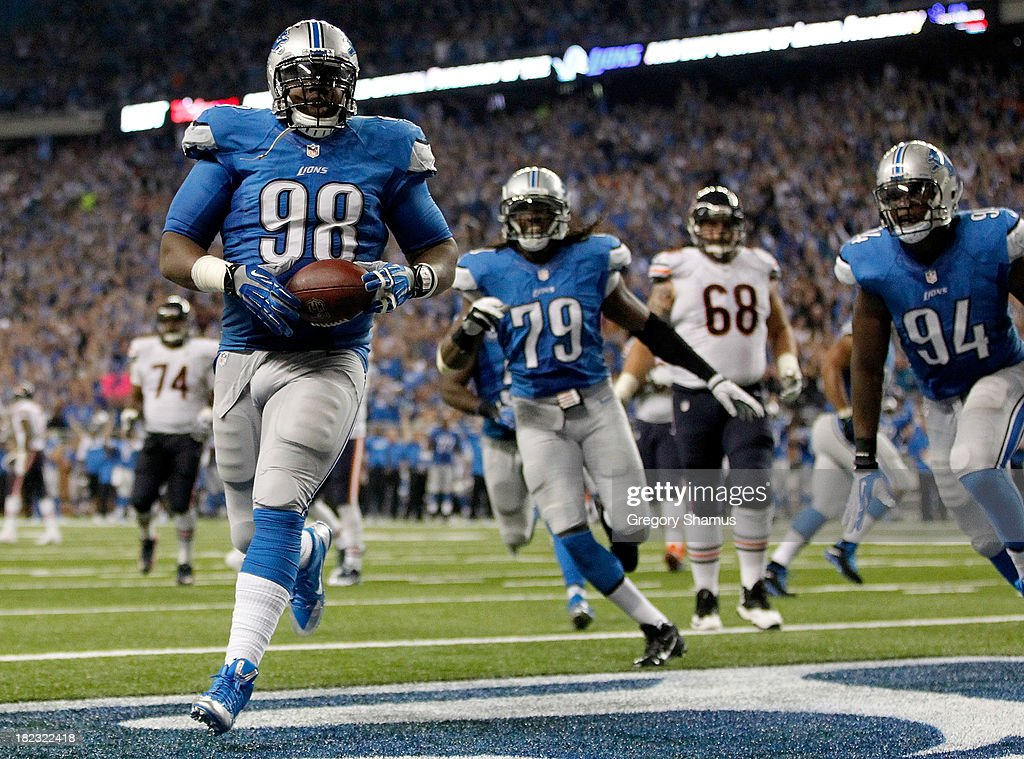Nick Fairley #98 of the Detroit Lions scores a touchdown off a fumble recovery in the third quarter while playing the Chicago Bears at Ford Field on September 29, 2013 in Detroit, Michigan.