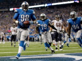 Nick Fairley of the Detroit Lions scores a touchdown off a fumble recovery in the third quarter while playing the Chicago Bears at Ford Field on...