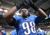 Nick Fairley of the Detroit Lions signals safety to the fans during the fourth quarter of the game New York Giants at Ford Field on December 22 2013...