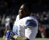 Nick Fairley of the Detroit Lions warms up before the game against the Chicago Bears on November 10 2013 at Soldier Field in Chicago Illinois