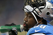 Nick Fairley of the Detroit Lions watches the action from the sidelines during the first quarter of the preseason game against the Jacksonville...