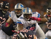 Nick Fairly and Ndamukong Suh of the Detroit Lions rush against the Chicago Bears at Soldier Field on October 22 2012 in Chicago Illinois The Bears...