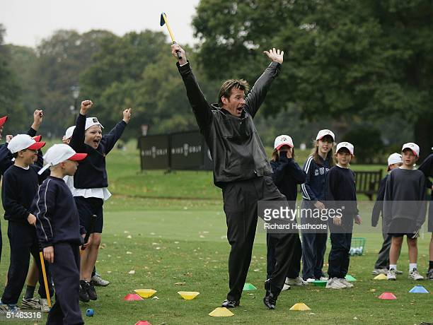 Nick Faldo joins in with local children in a TriGolf clinic during the 2004 Faldo Series Final held at Burhill Golf Club on October 11 2004 in...