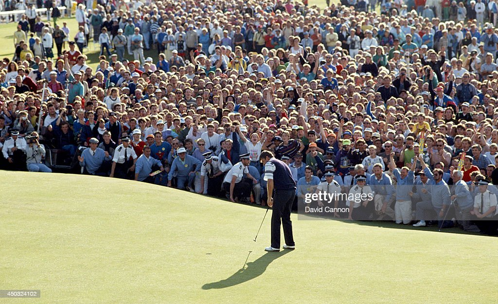 Nick Faldo of England hits his final putt on the 18th green on the way to his win in the 119th Open Championship played on the Old Course at St Andrews on July 22, 1990 in St Andrews, Scotland.