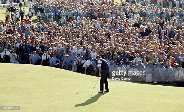 Nick Faldo of England hits his final putt on the 18th green on the way to his win in the 119th Open Championship played on the Old Course at St...