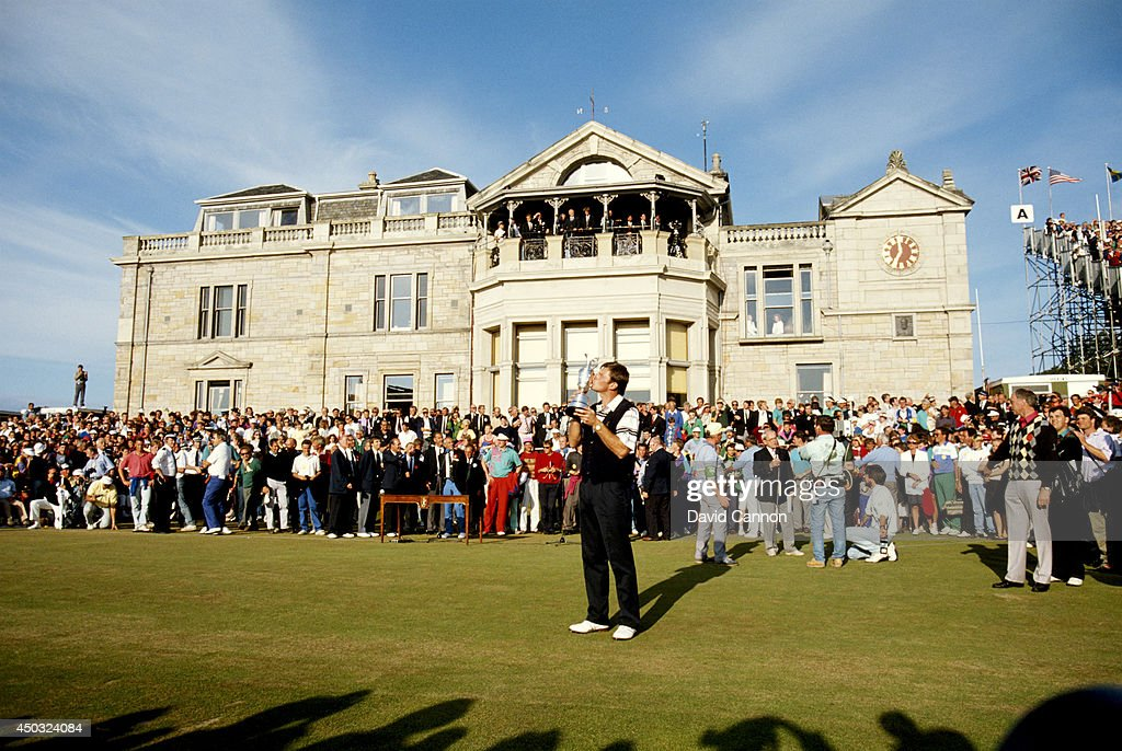 Nick Faldo of England holds the trophy after his win in the 119th Open Championship played on the Old Course at St Andrews on July 22, 1990 in St Andrews, Scotland.