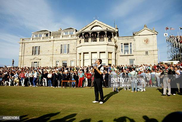 Nick Faldo of England holds the trophy after his win in the 119th Open Championship played on the Old Course at St Andrews on July 22 1990 in St...