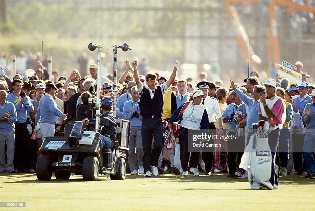 Nick Faldo of England raises his arms after breaking through the crowds on his way to the 18th green on the way to his win in the 119th Open Championship played on the Old Course at St Andrews on July 22, 1990 in St Andrews, Scotland.