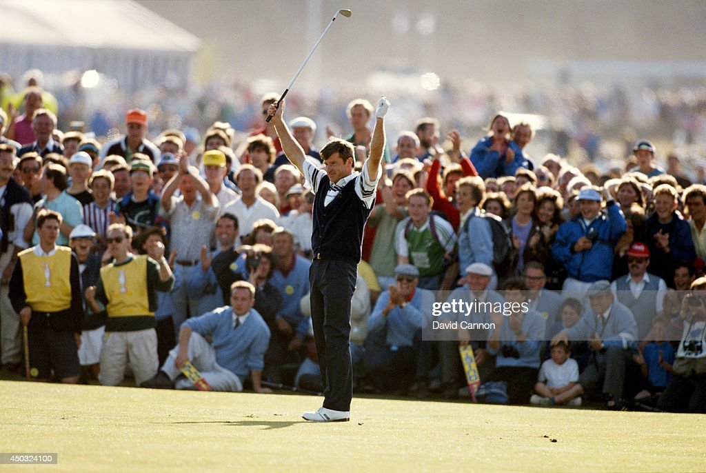 Nick Faldo of England raises his arms after his second shot to the 18th green on the way to his win in the 119th Open Championship played on the Old Course at St Andrews on July 22, 1990 in St Andrews, Scotland.